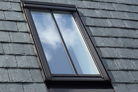 VELUX conservation window on grey slates with flashing